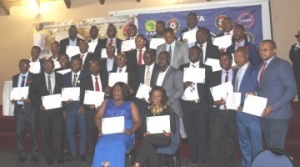 TWO GROUPS OF FOOTBALL PERSONNEL GRADUATE